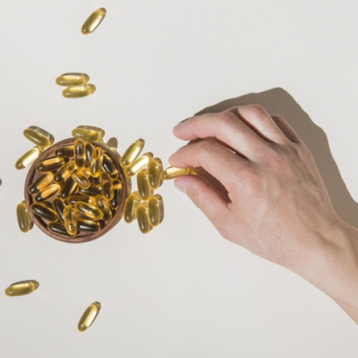 top-view-hand-picking-medical-capsules_23-2148529747