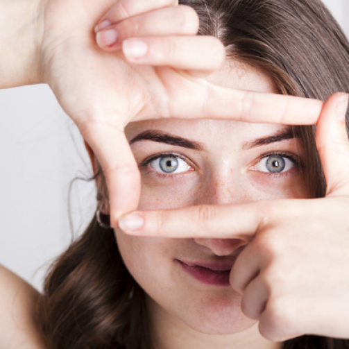woman-framing-eyes-with-fingers_23-2147835579