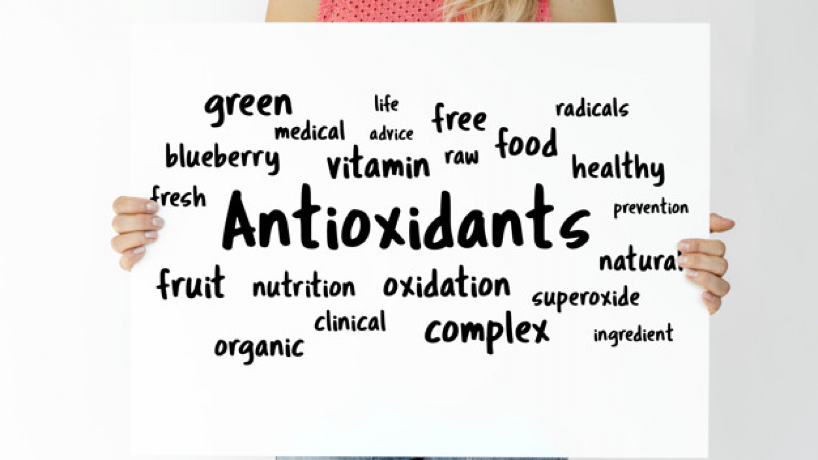 Woman holding a board with Antioxidants concept