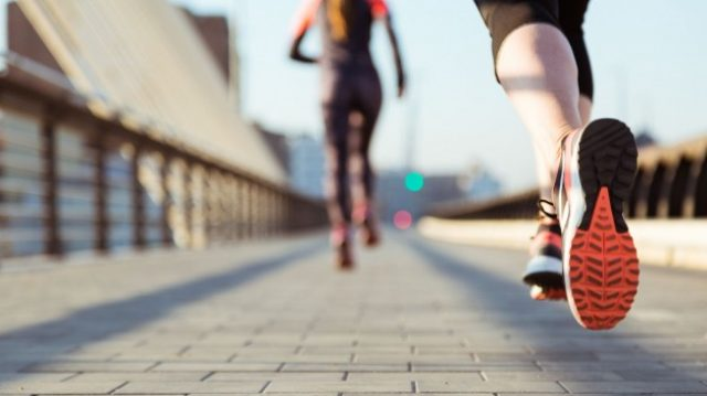 close-up-woman-running-with-unfocused-background_23-2147600468